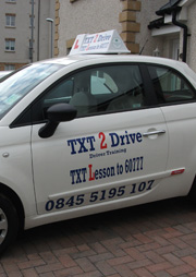 Txt 2 Drive logo on car